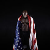 Male athlete carrying an American flag Stock Photography