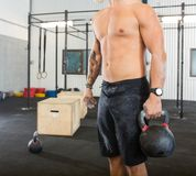 Male Athlete Carrying Kettlebell Royalty Free Stock Image