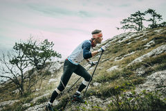 Male athlete climbs slope of mountain. Yalta, Russia - November 2, 2015: male athlete climbs slope of mountain during Mountain marathon Vertical kilometre AI Royalty Free Stock Photography