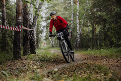 Male athlete a cyclist riding turn in woods. Chelyabinsk, Russia - June 5, 2016: male athlete a cyclist riding turn in woods during cross-country race New energy Stock Photos