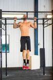 Male Athlete Doing Chin-Ups At Healthclub Royalty Free Stock Photo