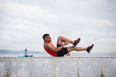 Male athlete doing crunches Stock Images