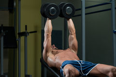Male Athlete Doing Heavy Weight Exercise For Chest Royalty Free Stock Image
