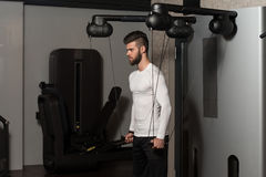 Male Athlete Doing Heavy Weight Exercise For Shoulders Stock Photography