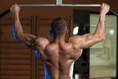 Male Athlete Doing Pull Ups Royalty Free Stock Image