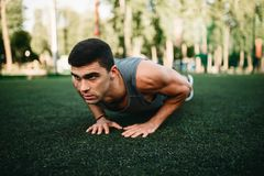 Male athlete doing push-up exercise outdoor stock photography