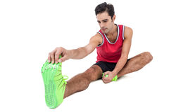 Male athlete doing stretching exercise. On white background Royalty Free Stock Photography