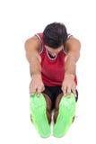 Male athlete doing stretching exercise. On white background Stock Photo