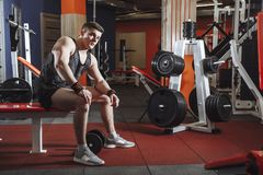 Male athlete with dumbbell during a workout. stock photos