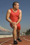 Male Athlete Exercising On Racetrack Stock Images