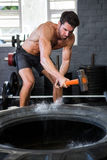 Male athlete exercising with sledgehammer Royalty Free Stock Photo