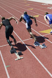Male Athlete Exploding Out Of The Starting Blocks Stock Images