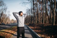 Male athlete on fitness workout outdoors. Runner in sportswear on training in park. Jogging or running Stock Photos
