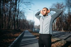 Male athlete on fitness workout outdoors. Runner in sportswear on training in park. Jogging or running Royalty Free Stock Photo
