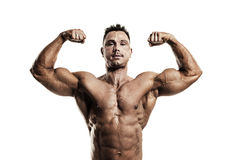 Male athlete flexing his muscles Stock Photos