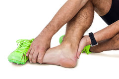 Male athlete with foot pain on white background royalty free stock photos