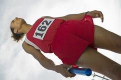 Male Athlete Holding Baton royalty free stock image