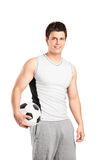 A male athlete holding a football Royalty Free Stock Photos