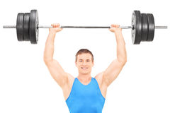 Male athlete holding a heavy weight Stock Photos