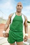 Male Athlete Holding Metal Ball. Portrait of an African American male athlete holding metal ball Stock Photography