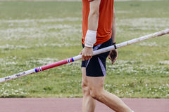 Male athlete holding a pole Stock Photo