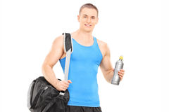 Male athlete holding a water bottle Royalty Free Stock Image