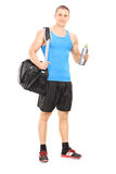 Male athlete holding a water bottle Stock Photography
