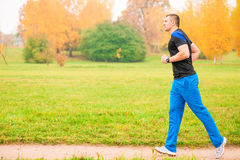 Male athlete jogging in the morning Royalty Free Stock Image