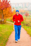 Male athlete jogging in the morning Stock Images