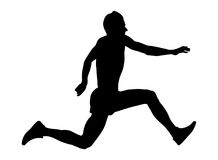 Male athlete jumper a triple jump. Black silhouette Royalty Free Stock Photo