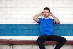 Male athlete listening music stock photography