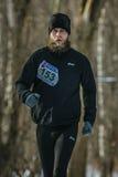 Male athlete with a lush beard runs Royalty Free Stock Image