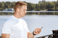 Male athlete organize his running playlist Royalty Free Stock Images