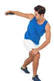 Male athlete playing discus throw on white background. Determined male athlete playing discus throw on white background royalty free stock photo