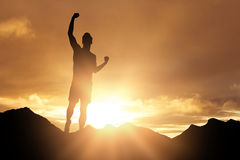 Composite image of male athlete posing after victory. Male athlete posing after victory against cloudy sky landscape royalty free stock photography
