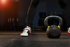 Male athlete preparing for kettlebell workout stock image