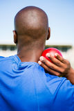 Male athlete preparing to throw shot put ball Royalty Free Stock Images
