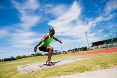 Male athlete preparing to throw shot put ball. In stadium Stock Photography