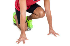 Male athlete in ready to run position Stock Image