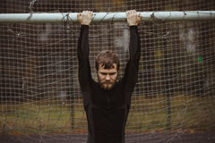 Male Athlete Resting On Soccer Field Royalty Free Stock Photos