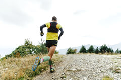 Male athlete runner. Running mountain marathon Stock Photos