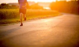 Male athlete/runner running on road Stock Image