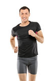 A male athlete running. Isolated on white background Stock Photos