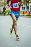 Male athlete running on the road Stock Photo
