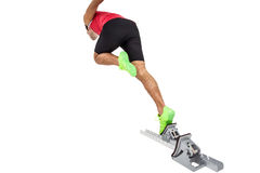Male athlete running from starting blocks. On white background Royalty Free Stock Photos