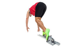 Male athlete running from starting blocks. On white background Royalty Free Stock Photo