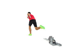 Male athlete running from starting blocks. On white background Royalty Free Stock Image