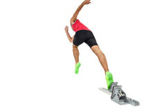 Male athlete running from starting blocks. On white background Royalty Free Stock Images