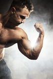 Male athlete showing biceps Stock Photo