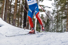 Male athlete skier coming down mountain on skis Stock Images